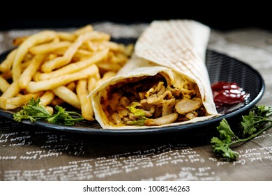 Mexican fajita wraps with grilled chicken fillet and fresh vegetables