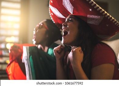 Mexican fan celebrating during game at home