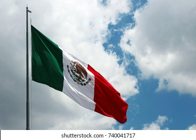 Mexican flag in the air or blue sky