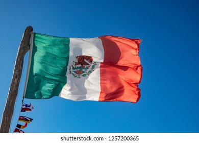 mexican flag in the blue sky