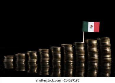 Mexican flag with lot of coins isolated on black background