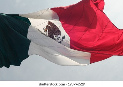 The Mexican flag flying, seen in the middle of the Zocalo square in Mexico City