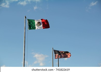 A Mexican flag and a flag of the United States of America, marking the border between Ciudad Juarez, Mexico, and El Paso, Texas