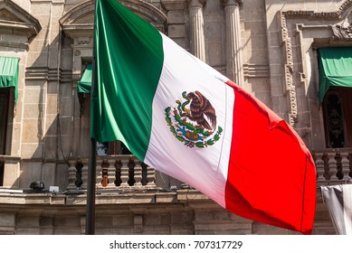 Mexican flag waving in front of the town hall
