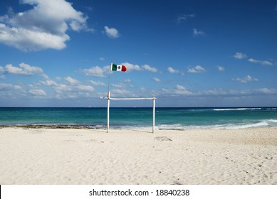 Mexican flag waving over the beach in playa del carmen