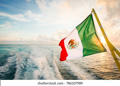 Mexican flag waving over the Cancun waters