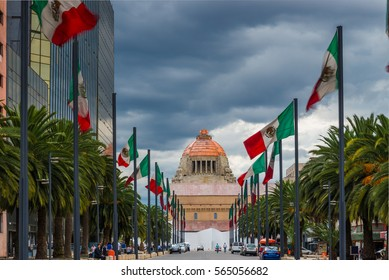 Mexican flags line the street to the Monument to the Revolution in downtown Mexico City, Mexico.