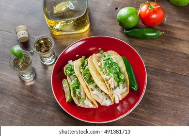 Mexican Food Chicken Tacos With Ingredients And Tequila Shots With Lime For Drinking. Top View Selective Focus With Copy Space.