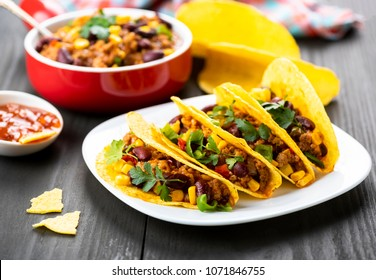 Mexican food - delicious tacos with minced meat, beans and corn