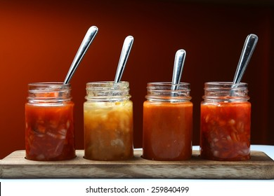 Mexican food dips and sauces in bottles Photo of different Mexican food dips and sauces in bottles