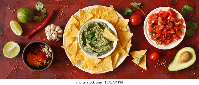 Mexican food party sauce guacamole, salsa, nachos and ingredients. Top view. Flat lay. Banner.