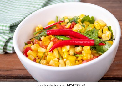 mexican fresh corn salad bowl on a wood rustic wable