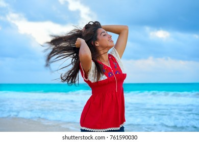 Mexican girl embrodery dress at sunset in Caribbean sea
