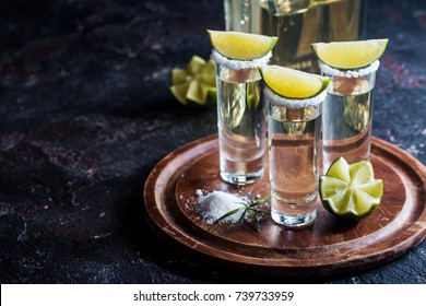 Mexican Gold Tequila with lime and salt on black background with copyspace.