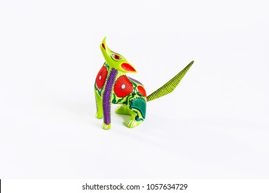 Mexican green and red alebrije from oaxaca isolated on white background. From above