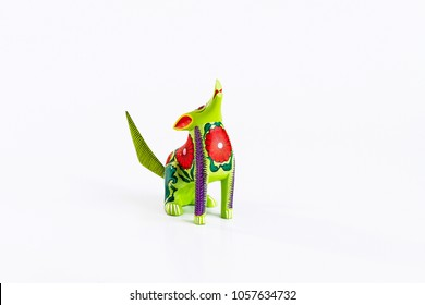 Mexican green and red alebrije from oaxaca isolated on white background.