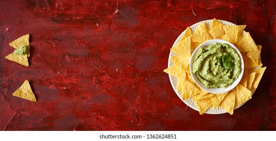 Mexican guacamole and salsa dip with nachos tortilla chips. Banner.