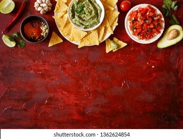 Mexican guacamole and salsa dip with nachos tortilla chips