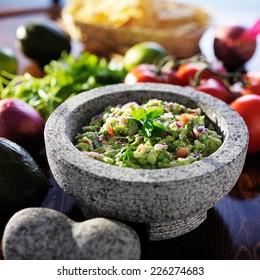 mexican guacamole in stone molcajete