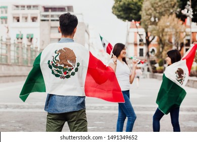 mexican guys cheering Viva Mexico on independence day in Mexico city