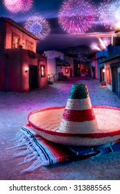 """Mexican hat """"sombrero"""" on a """"serape"""" in a mexican village at twilight and fireworks"""
