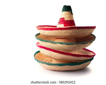 """Mexican hats or """"sombreros"""" stacked up on top of each other, isolated on white"""