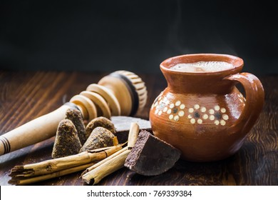 Mexican hot cocoa with ingredients and traditional wooden whisk