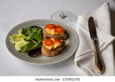 Mexican houmous on toast with salad garnish