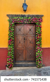 Mexican house Colonial style door with flowers decoration in San Miguel de Allende Mexico