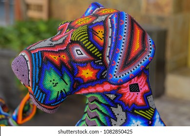 Mexican Huichol art, head of a dog made with colorful beads