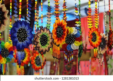 Mexican Huichol Beaded Chaquira Flower Necklaces in the market of Cholula, Puebla (Mexico)