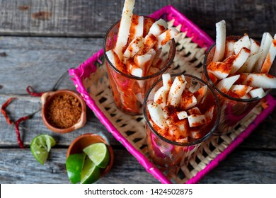Mexican jicama fruit cutted with green  lime, chili powder and chamoy