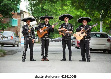Mexican, Latin American, Spanish. Musicians on the streets.