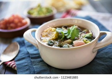 Mexican Lime Tortilla Soup wot corn and cilantro.