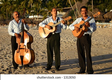 Mexican mariachi band playing on a beach