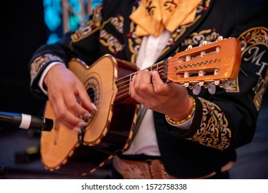 Mexican Mariachi singing with guitars and trumpets