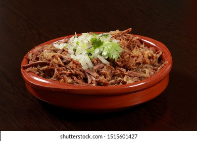 Mexican (Michoacan) slow cooked pulled beef, served with tacos, onion, salsa banderita and spicy chilli sauce.