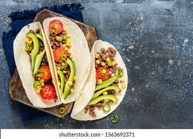Mexican Minced Beef Tacos with Vegetables and Corn Salsa, copy space for your text