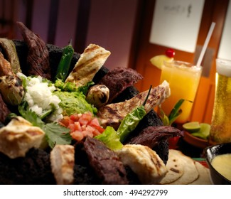 mexican molcajete with meat chicken and drink