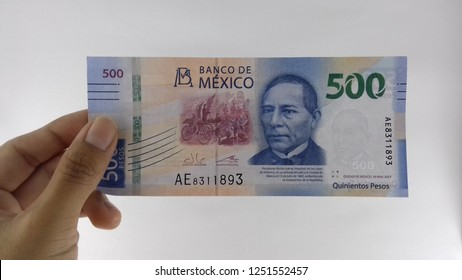 Mexican money in hand