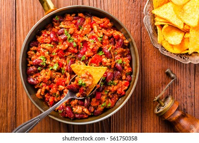 Mexican nachos with chili con carne. Top view.