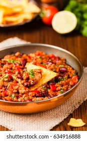 Mexican nachos with chili con carne. Front view.