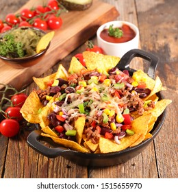 mexican nachos chips- tortilla chip with bean, guacamole, corn and cheese