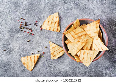 Mexican nachos on a light background. Top view