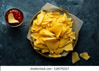 Mexican nachos with  tomato ketchup sauce. Mexican food concept. Yellow corn totopos chips with sauce. Top view.
