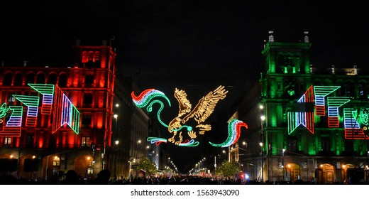 Mexican national shield, hung in two classic buildings in the Zocalo of Mexico City.