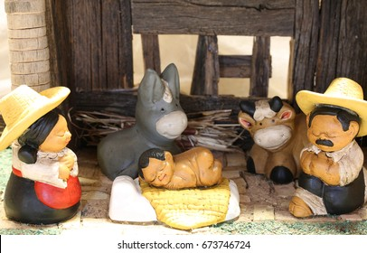 Mexican Nativity scene with holy family in clothes in South American style