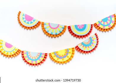 Mexican paper garlands decorating. Cinco De Mayo colorful traditional picado banner festive. Creativity paperwork. Step by step skill.