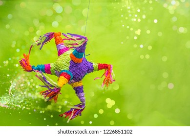 mexican piñata party hanging on blue and green background celebrating birthday, christmas, party, party songs, figure in the shape of star and donkey, family fun, Mexican pinata used on posadas
