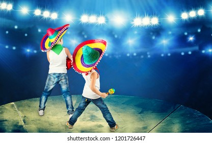 Mexican party. Two brothers in sombreros perform on stage, sing serenades.